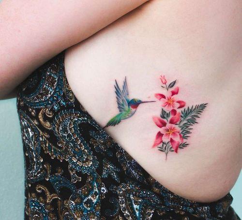 breast tattoo colibri